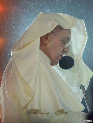 Pope speaks in the rain