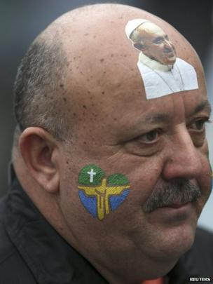 Man with image of Pope stuck to his forehead
