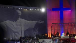 Image of Christ the Redeemer statue projected onto screen at Copacabana event