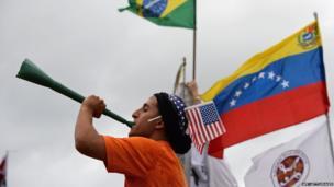 Festival attendee blows vuvuzela