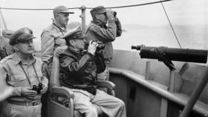 General Douglas MacArthur, seated, and members of his staff view pre landing bombardment and air strikes from the flag bridge of the USS Mt McKinley in Korean waters off Inchon, as US forces begin their offensive in that section 1950