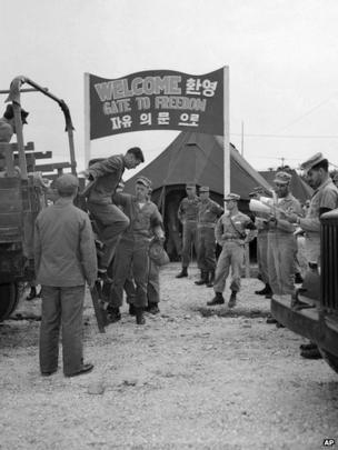 "Billy J. Buchanan of Atlanta, Georgia, arrives at UN POW exchange point, Panmunjom, Korea, 6 August 1953, on second day of ""Operation Big Switch."""