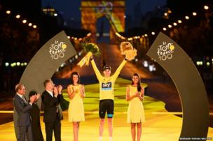 Britain's Chris Froome on the podium in Paris