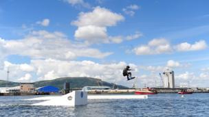 Wakeboarding participant performs stunt in Belfast docks