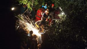 Rescue workers cut through the wreckage of the crashed coach, near Avellino (29 July)