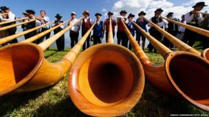 Alphorn players perform in Nendaz, Switzerland.