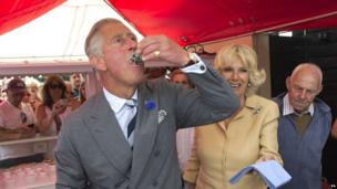 The Prince of Wales eats an oyster with the Duchess of Cornwall at the Whitstable Oyster Festival in Kent.