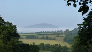 Tor y Foel circled in mist