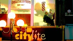 A barber's shop above the Citylite Cafe