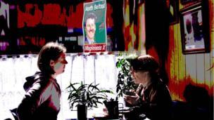 Women under an election poster