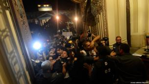 Police clash with anti-government protesters as they try to occupy the Rio de Janeiro's Municipal Chamber