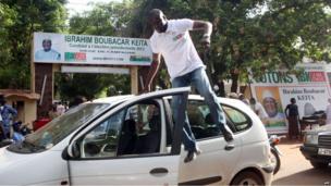 Supporters of Mali's former prime minister Ibrahim Boubacar Keita celebrate in Bamako on 30 July 2013