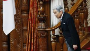 Emperor Akihito leaves after reading a statement to officially open the extraordinary diet session at the upper house of parliament in Tokyo Friday, Aug. 2, 2013.