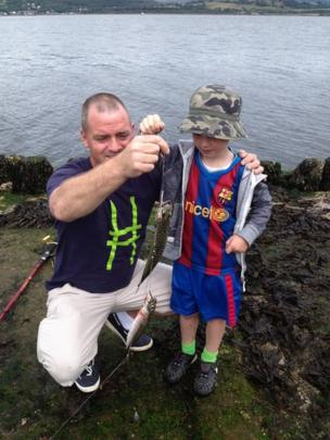 Jamie fishing with his dad