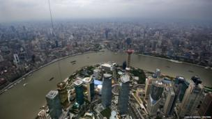 "A general view of Shanghai""s financial district of Pudong is seen from the top of the Shanghai Tower, which is undergoing construction, August 2, 2013."