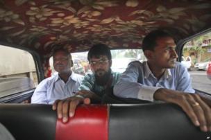 people travel in a Mumbai Premier Padmini taxi, in Mumbai, India