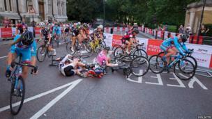 Women pro cyclists crash turning a corner near St James' Park, London