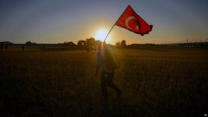 A man walks with a national flag outside the Silivri jail complex in Turkey