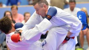 Thierry Delhief from French Polynesia against Colin McDonald from Northern Ireland pictured at the karate event held at the Shankill Leisure Centre, Belfast.