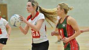 The Police Service of Northern Ireland take on the Northern Ireland Fire and Rescue Service in the netball competition at the Aurora Centre in Bangor, County Down.