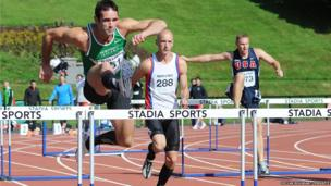 Athletes compete in the 100 metres hurdles Decathlon event at the Mary Peters Track in South Belfast.