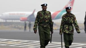 Kenya Airways aircraft stay grounded after a huge fire left all flights suspended at the Jomo Kenyatta International Airport, as soldiers patrols the grounds, in Kenya's capital Nairobi 7 August 2013.