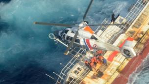 A helicopter hovers over a sinking Chinese fishing vessel