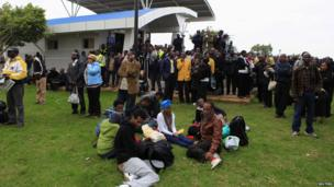 "Stranded passengers and onlookers gather after a fire disrupted all operations at the Jomo Kenyatta International Airport in Kenya""s capital Nairobi 7 August 2013."