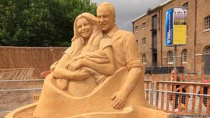 Sand sculpture of Duke and Duchess of Cambridge with the baby prince
