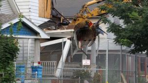 The home of Ariel Castro is torn down in Cleveland on Wednesday, 7 August, 2013