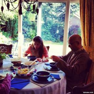 Rehana's daughter and husband eat traditional Eid breakfast. Photo: Rehana Mir