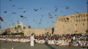 Men sit in square during Eid prayers in Libya. Photo: Magdi Altajory
