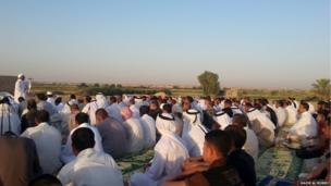 Men are led in prayer in Tikrit, Iraq. Photo: Nazer Al Mobidy