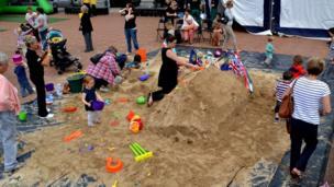 People building sand castles