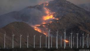Fire spreads up the north side of the San Jacinto Mountains, near wind turbines at the Silver Fire, near Banning, California