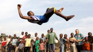A youth jumps through the air as he plays at the Don Bosco Ngangi community centre in Goma, North Kivu region in the Democratic Republic of Congo
