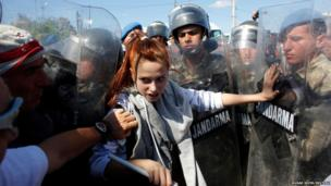 A protester stands against Turkish soldiers during clashes near Silivri