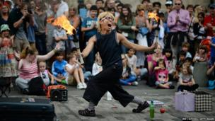 A street entertainer performs on Edinburgh's Royal Mile