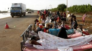 Homeless people in beds beside the road in Khartoum, Sudan - Tuesday 6 August 2013