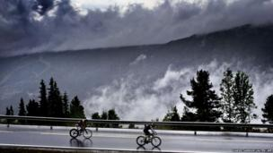 Triathletes ride on bicycles during the Norseman xtreme triathlon in Eidfjord, Norway