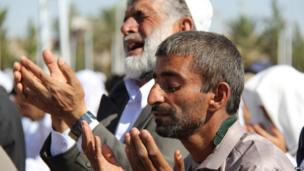 Men offering prayers. Photo: Amir in Zahedan Iran