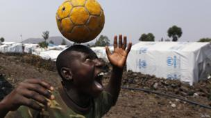 A young Congolese boy heads a football - Sunday 4 August 2013