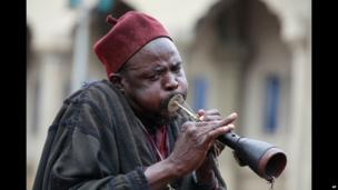 A man blowing a horn during Eid celebrations in Maiduguri, Nigeria - Thursday 8 August 2013