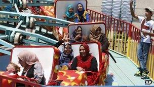Iraqis at Baghdad amusement park, 10 August