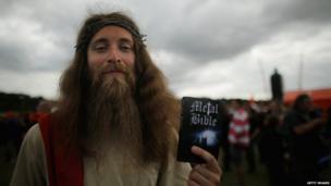 Music fan with heavy metal bible