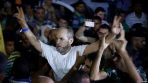 A freed Palestinian prisoner celebrates in northern Gaza (13 August 2013)