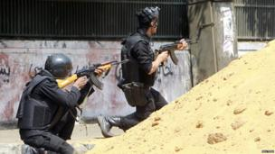 Riot police open fire at members of the Muslim Brotherhood and supporters of deposed Egyptian President Mohammed Morsi around Cairo University and Nahdet Misr Square, where they are camping in Giza, south of Cairo 14 August 2013