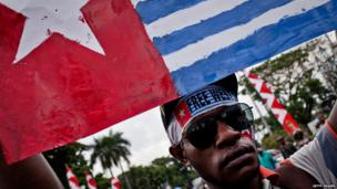 A student protester holds the Morning Star flag, used by supporters of West Papuan independence, during a demonstration against the signing of the so-called 1962 New York Agreement, which established the administration of West New Guinea. 15 August 2013
