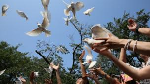 People release doves during a ceremony at the Yasukuni shrine on the 68th anniversary of Japan's surrender in World War II.