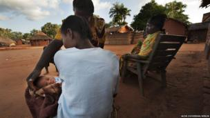 Chimene Kpakanale introducing her new baby to a neighbour in Obo, Central African Republic